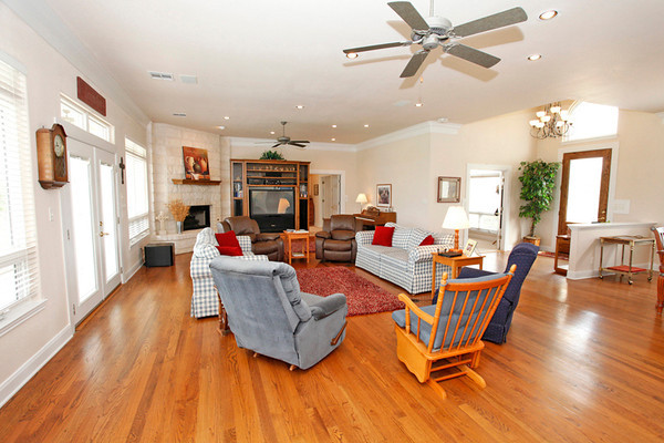 Large open living room with woodfloors on Lake LBJ