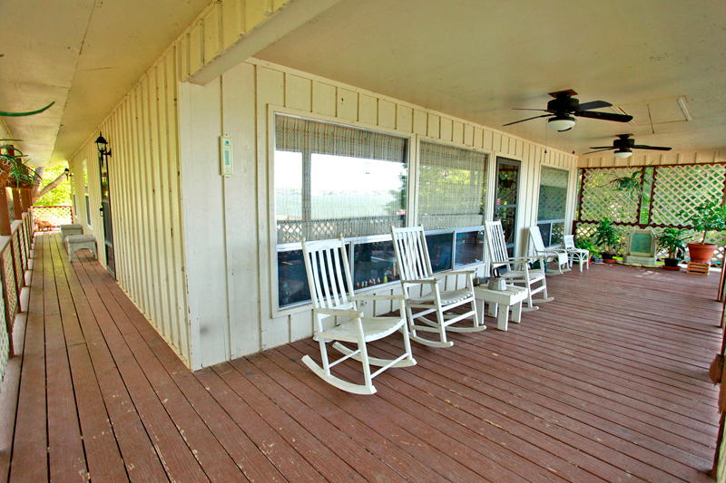 This wonderful porch is perfect place to watch a Lake LBJ sunset