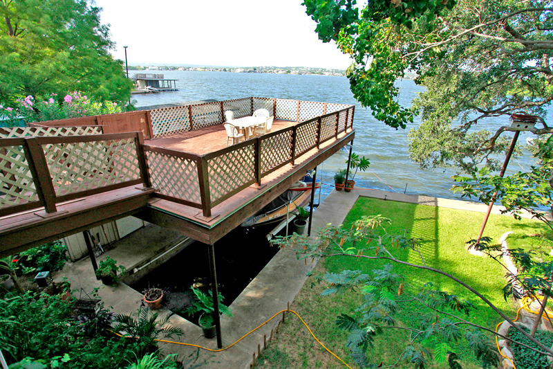 Great shot from the balcony of a wonderful Lake LBJ investment opportunity