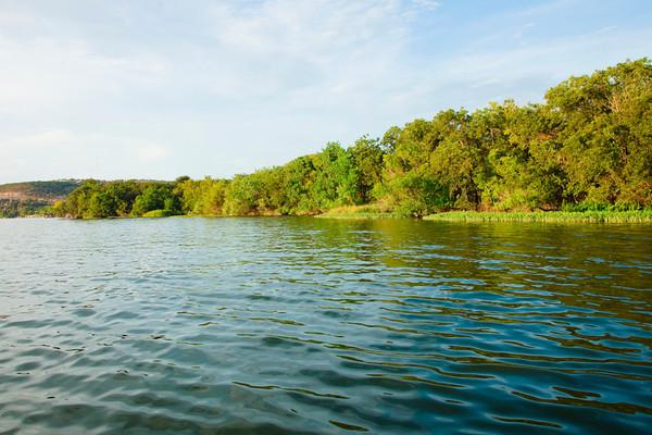 shot taken near Kingsland that shows an abundance of water and greenery on Lake LBJ